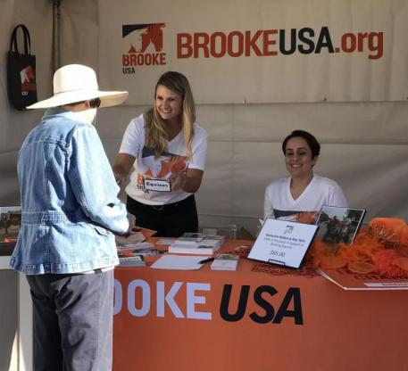 Brooke USA staff working the booth at Charlotte Dujardin's clinic in California.