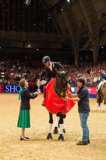 Carl Hester (GBR) and Nip Tuck receive the Reem Acra Trophy from the Princess Royal