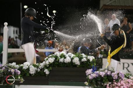 The top three riders in their celebratory champagne spray after the conclusion of competition