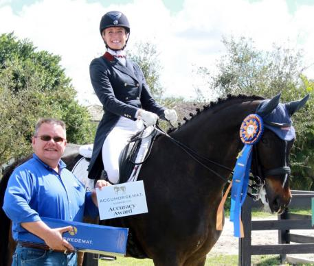 Charlotte Jorst, riding Ray Dance, wins the Accuhorsemat Accuracy Award at the Adequan Global Dressage Festival, presented by Thomas Willetto of Acuswede