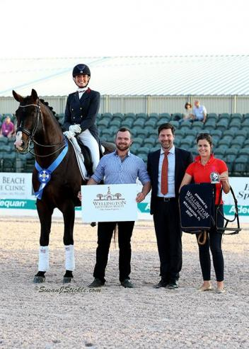 Charlotte Jorst and Kastel's Nintendo in their presentation ceremony with Cameron Scott of Wellington Equestrian Realty, judge Hans Christian-Matthiesen (DEN), and Cora Causemann of AGDF. week 5, GDF 2017
