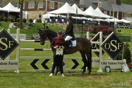 Christina Firestone and Arwen in their winner's presentation with Rob Gray of T & R Development.