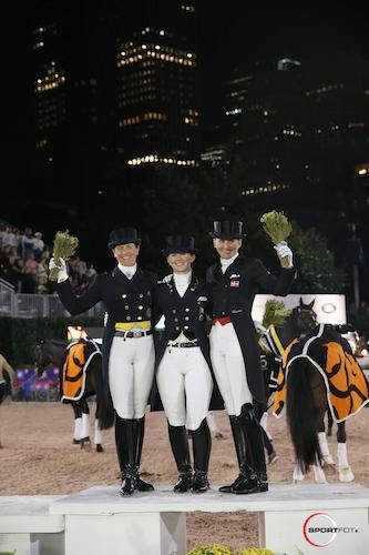 The top three in the Grand Prix Freestyle (L to R):  Tinne Vilhelmsen-Silfven, Judy Reynolds,  and Mikala Gundersen. 2016 Central Park Horse Show