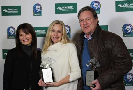 Carol Cohen presents Katherine and Mark Belissimo with the Global Dressage Visionary Award