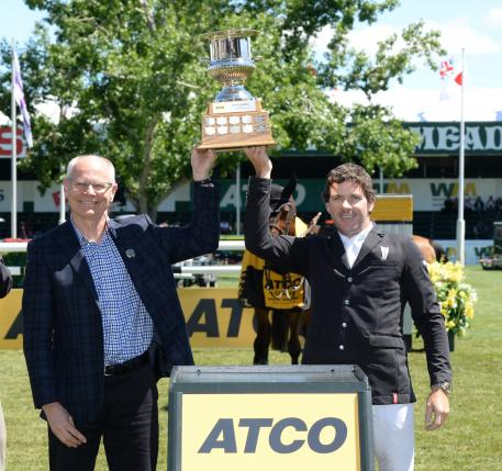 Conor Swail raises yet another trophy, this time with Stephen Lockwood, President & COO, ATCO Structures & Logistics.