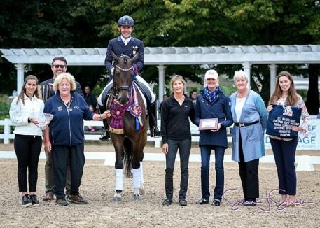 Dr. Cesar Parra claimed victory aboard Fashion Designer OLD at the Lamplight Equestrian Center in Wayne, IL (Photo: Susan J. Stickle)