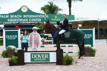 Eduardo Menezes in his presentation ceremony with ring master Steve Rector and Wendy Manganelli of Dover Saddlery.