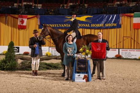 Elizabeth Reynolds and Own the Moment Win NAL Adult Hunter Finals