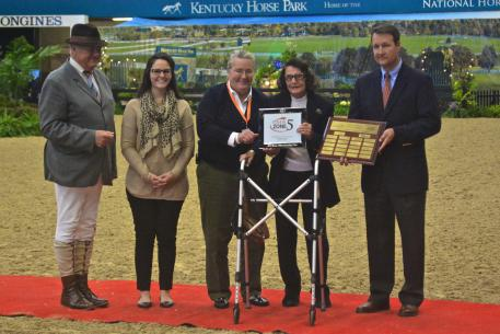 Elizabeth Johnson accepts the award for USHJA Zone 5 Horseman of the Year.