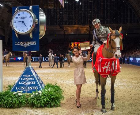 Emanuel Gaudiano (ITA) riding Admara are presented with a Longines watch by Katrina Jones, Branding Director, Longines Uk and Ireland