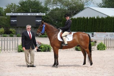 Judge Gary Duffy presented the LIHSSRD Walk-Trot Equitation Academy Class championship at the 40th annual Hampton Classic.