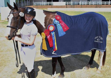 The Horse of Course awarded Emily Moser and No Cameras Please with the High Score Award embroidered cooler at the Green Country Dressage Classic I & II