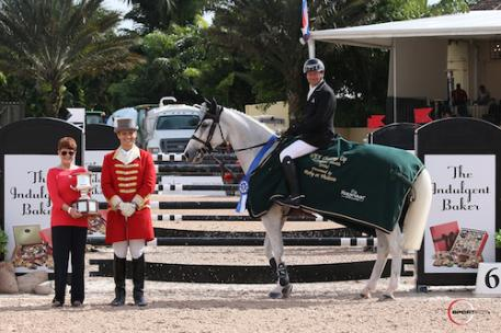 Eric Lamaze and Check Picobello Z in their winning presentation with ringmaster Christian Craig and Debbie Lane, who presented the pair with the Barry Louise Lane Perpetual Memorial Trophy.