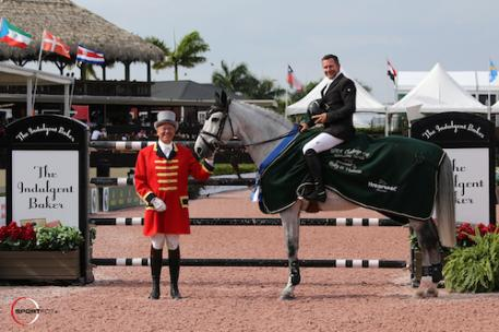 Eric Lamaze and Houston in their winning presentation with ringmaster Steve Rector. WEF week 3 2017