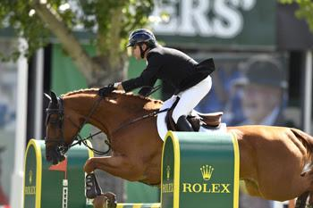 Canada's Eric Lamaze competes on opening day of the Spruce Meadows 'Masters' tournament with Chacco Kid