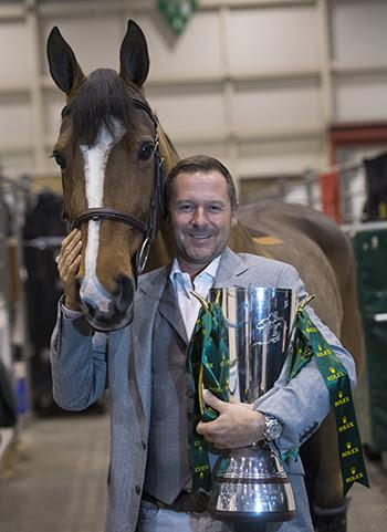 Eric Lamaze and Fine Lady 5, owned by Artisan Farms, with the Rolex IJRC trophy.