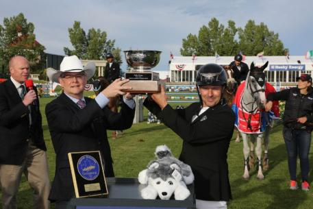 Eric Lamaze raises the Husky Energy Cup trophy with Rob Peabody, Chief Operating Officer, Husky Energy.