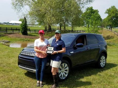 Helen McDonald, Events and Partnerships Manager, Jaguar Land Rover North America (right) presents Erin Sylvester (left) with the keys to her 2017 Land Rover Discovery Sport for being the 'Best Ride of the Day.'
