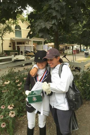 Ferris Yanny congratulates Camille Molten at the USEF Dressage Seat Medal Finals