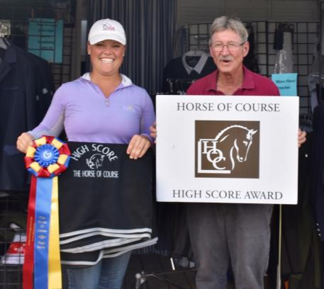 Gracia Huenefeld (left) is awarded The Horse of Course High Score Award by Marty Haist (right).