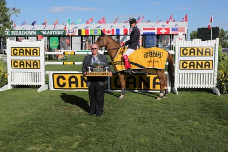 Gregory Wathelet and Algorhythem in their winning presentation with John Simpson, Chairman, The CANA Group of Companies (Photo: © Spruce Meadows Media Services)