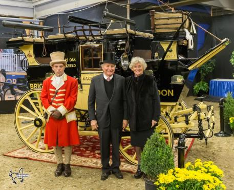 Harvey (center) and Mary (right) Waller with their historic road coach the 'Old Times,' winner of the Green Meadows Four-In-Hand Coaching Appointments class at the Royal Horse Show.