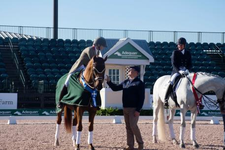 Heather Blitz riding Praestemarkens Quartero in the prize giving with Triple Crown Nutrition CEO Rob Daugherty