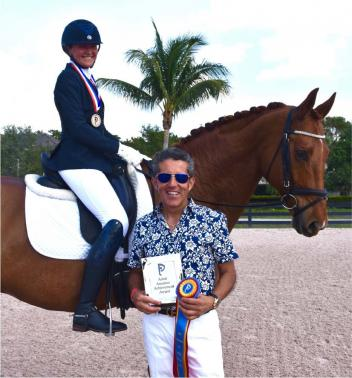Adult Amateur Achievement Award winner, Helle Goodrich, riding Fürst Rubin, was excited to receive the award from Dr. Cesar Parra