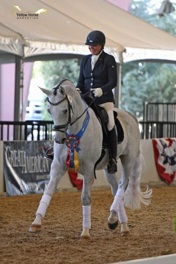 Fifty years after her first CDS Championship Show in 1968, Hilda Gurney earned yet another championship title by topping a hard-fought Great American/USDF Third Level Freestyle class with 72.833% aboard Lotta Silver.