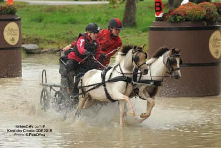 Mary Phelps and Bram Chardon in the water at the Kentucky Horse Park