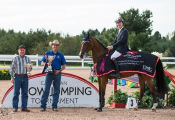 Following three phases of competition, Ian Millar won the Caledon Cup, presented by Bob Northcott of Arthur Chrysler (left) and Ross Millar of RAM Equestrian, for the second year in a row at the CSI2* Canadian Show Jumping Tournament. Photo by Ben Radvanyi