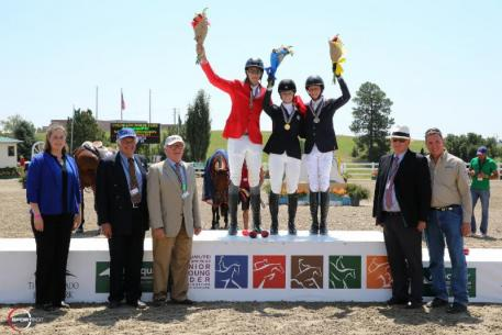 Lucy Matz, Carlos Hank Guerrerio, and Brian Moggre in their presentation ceremony for the USHJA North American Junior & Young Rider Show Jumping Championships Junior Rider Individual Final with Katie Patrick; Director of Sport for the USHJA; David Ballard, Foreign Technical Delegate; Phillip Rozon, President of the FEI Ground Jury; Michael Stone, President of The Colorado Horse Park; and Allyn Mann of Adequan®.