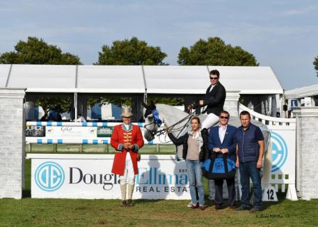 Ireland's Shane Sweetnam won the $75,000 Douglas Elliman Grand Prix Qualifier CSI4* Presented by Longines. L-R Kathryn Gilbertson of the Blue Buckle Group (owners of the horse); Carl Benincasa Regional VP of Sales, Douglas Elliman and Paul Tracey of the Blue Buckle Group. © Shawn McMillen