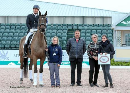 Jaimey Irwin and Donegal V in their winning presentation with their groom Rachel Manshreck-Head, judge Carlos Lopes, Janet Richardson-Pearson of Chesapeake Dressage Institute, and Cora Causemann of AGDF.