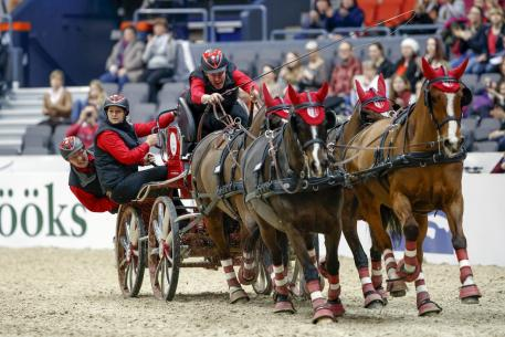 Jérome Voutaz from switzerland with his Four-in-Hand team. FEI World Cup™ Driving Final Photo (FEI/Stefan Lafrentz)