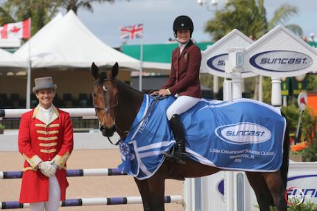 Jessica Springsteen and Davendy S in their winning presentation  with ringmaster Christian Craig.