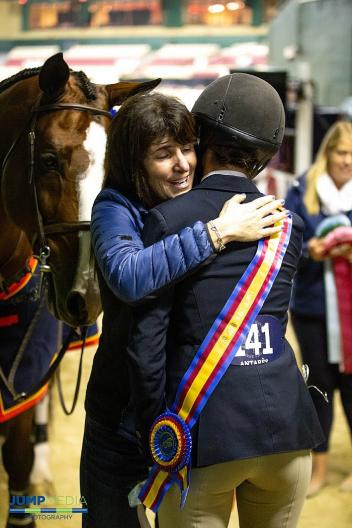 """Jessica Stone gets a hug from her mom after winning the USHJA 3'3"""" Jumping Seat Medal Final."""