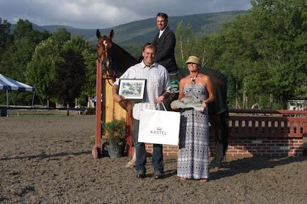 Jimmy Torano (aboard Argentus) and Lion Hearted are presented as the winners of the $5,000 NEHJA Performance Stake Hunter Derby, presented by Eastern Hay, by Chris Johnson of Eastern Hay and Daryl Portela at the Vermont Summer Festival. (Photo: David Mullinix Photography)