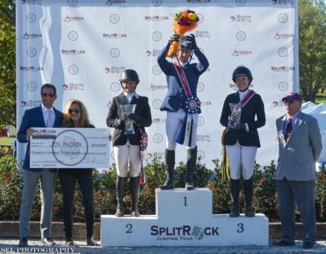 Jonathan McCrea stands atop the podium after the 00,000 CSI3* Grand Prix win
