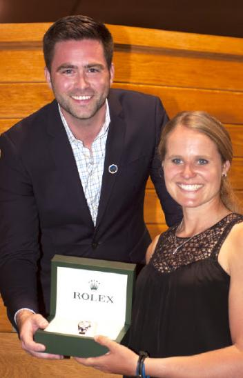 Jordan Linstedt of Washington won the competitors's draw for a Rolex watch at the welcome reception. Kyle Younghans of Rolex Watch USA presents her with her prize. (Michelle Dunn Photo)