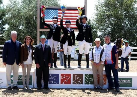 Jenna Upchurch, Vanessa Creech-Terauds, and Carlos Maldonado Lara in their medal presentation ceremony with Stephan Hienzsch, Executive Director of USDF; Meg Krueger, COO of The Colorado Horse Park; Bill Moroney, CEO of USEF; Jennie Loriston Clarke, Foreign Technical Delegate; and Allyn Mann of Adequan®.