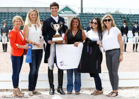 The 2016 Overall Florida International Youth Dressage Champion Juan Matute Jr. (ESP) in the presentation ceremony with Terri Kane, Kim Boyer, Jessica Newman and Molly McDougall from JustWorld International, and Sarah Davis