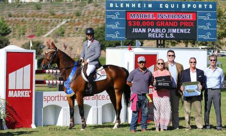 Juan Pablo Jimenez Torres celebrates the win with his team, along with Melissa Brandes and Robert Ridland of Blenheim EquiSports and Markel Insurance's Brandon Seger and Chris Norden