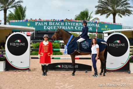 Kaitlin Campbell and Rocky W in their presentation ceremony with ringmaster Christian Moreno and Kelly Molinari of Equiline