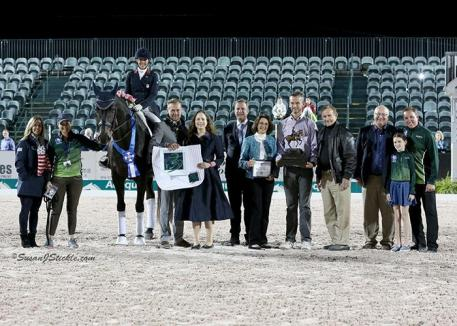 Kasey Perry-Glass and Goerklintgaards Dublet in their presentation ceremony with Diane Perry, groom Cassie Benson, Endel Ots and Bethany Peslar of Everglades Dressage, judge Christoph Umbach (LUX), Mary Anne McPhail of the Palm Beach Dressage Derby, FEI Steward Walter Bagley, Walter McPhail of the Palm Beach Dressage Derby, Michael Stone of Equestrian Sport Productions, Grace Collins, and Allyn Mann of Adequan®.