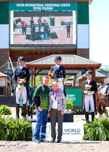 Kasey Perry-Glass, Adrienne Lyle, and Belinda Trussell in their presentation ceremony with Allyn Mann of Adequan® and judge Katrina Wuest (GER).