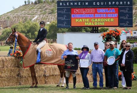 Katie Gardner is all smiles as she and Maldini celebrate the win  in the 0,000 USHJA International Hunter Derby