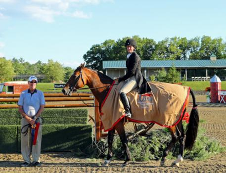 Kelley Farmer winning the 00,000 USHJA International Hunter Derby pictured with trainer Larry Glefke.