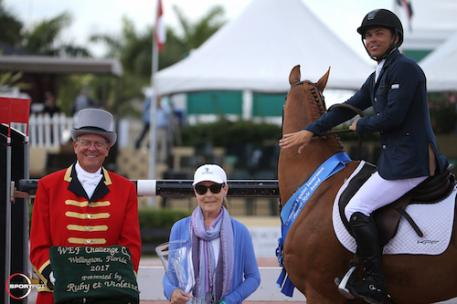 Kent Farrington and Creedance in their winning presentation with ringmaster  Steve Rector and Laura Fetterman of Champion Equine Insurance. WEF, week 7, 2017