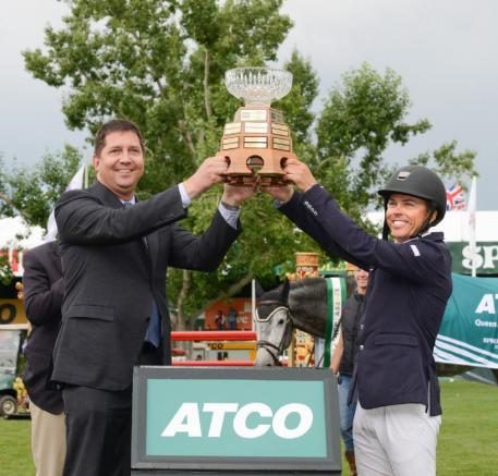 Kent Farrington raises the Queen Elizabeth II Cup with Wayne Stensby, Managing Director, ATCO's Electricity Global Business Unit.